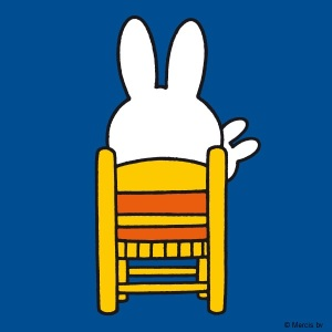 Miffy sitting on chair with doll
